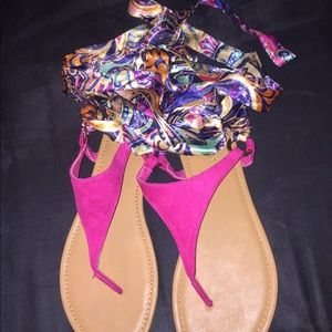 Flat, strapped sandals.